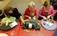 Dorothy Morgan of Forney (from left), Marilyn Waisanen of Dallas and Stacy Tackett of Richardson work on lace projects during the Dallas Lace Society's weekly meeting.( Vernon Bryant  -  Staff Photographer )