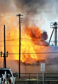 Thursday's fire engulfed East Texas Ag Supply in flames just 30 minutes after its owner had left the building.(Chuck Merickel)