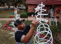 George Slater strung lights for his aunt, an Interlochen resident. Friends and family pitch in to make sure the show goes on.