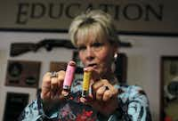 Almond shows off some of the merchandise. Pink shotgun shells. How cool is that?