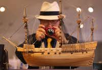 A visitor to The Mary Rose Museum takes a photograph of a 1:80 scale model of the Tudor warship for sale in the museum shop for GBP 285 on May 30, 2013 in Portsmouth, England.