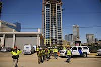 Workers walked away from a construction site on lockdown during the standoff.( G.J. McCarthy  -  Staff Photographer )