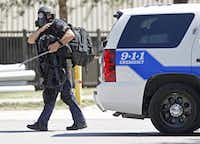 A Dallas SWAT team member left the scene of the standoff.( Michael Ainsworth  -  Staff Photographer )