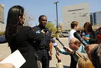 Dallas police Sgt. Warren Mitchell briefed the media during the standoff.( G.J. McCarthy  -  Staff Photographer )