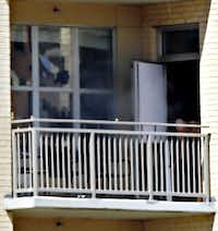 The suspect opened a patio door for fresh air after police lobbed gas canisters into the apartment.( G.J. McCarthy  -  Staff Photographer )