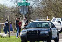 Fort Worth residents gathered March 15 near where Officer Matt Pearce was gravely wounded in a shootout. (Lawrence Jenkins/Special Contributor)