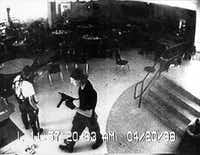 This frame grab from security video shows Eric Harris (left) and Dylan Klebold in the cafeteria of Columbine High School in Littleton, Colo., on April 20, 1999. The teens killed 12 students and a teacher before taking their own lives.