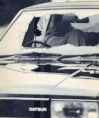 A blanket covers a body at the wheel of a car with shattered windows on Aug. 19, 1987, in Hungerford, England.  The driver was one of 16 people fatally shot by Michael Ryan before he killed himself after being cornered by police.
