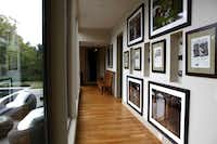 A hallway with photographer Jeremy Lock's photographs and cameras at the home of D'Andra Simmons and Jeremy Lock.