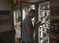 Jeremy Zettler selects a pre packaged meal from Simply Fit Meals at Northwest Highway and Hillcrest Rd. in Dallas.