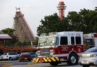 Rescue teams went to the scene at Six Flags Over Texas after a woman fell from the Texas Giant roller coaster about 6:30 p.m. Friday. The ride was shut down for the evening as investigators began looking into the cause of the accident.Tom Fox - Staff Photographer