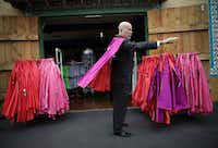 "Angus Wynne III, son of Six Flags Over Texas founder Angus Wynne Jr., tries on a souvenir Superman cape after speaking at a ceremony honoring the park's 50th anniversary. The younger Wynne recalled how the park's original name - Texas Under Six Flags - didn't quite fly with his mother, who said, ""Texas ain't under nothing."""