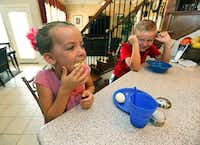 Madeline entertains her brother eating a half of a hard-cooked egg during breakfast.