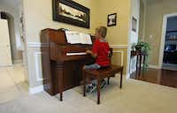 After a bike ride with his family, Jackson  practices piano.