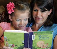 Madeline Fowers reads with her mom.