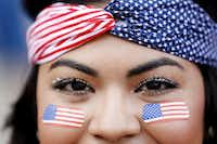 Karina Cisneros of Dallas wore flag face paint and a bandanna to show her support for the U.S. team, which was playing in Brazil.( Andy Jacobsohn  -  Staff Photographer )