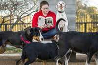 Tracy Cox reads a book as she visits the Johnny Steele Dog Park in Buffalo Bayou Park with her dog Toby on Feb. 10, 2015, in Houston. (Smiley N. Pool/Staff Photographer)