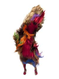 Nick Cave's soundsuit consists of human hair and knitted yarn wrapped tightly around a metal armature.