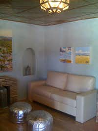 The Spa at the Gage features artwork and muted colors in the guest lounge.