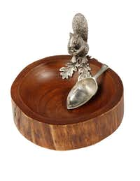 Nuttin' but fun: A wood bowl with a pewter squirrel and spoon, molded on the back like an acorn, is perfect for serving nuts and snacks. $90 at Culinary Connection, Plano.