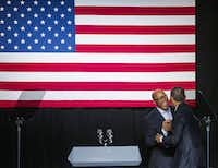 Former Dallas mayor Ron Kirk shakes hands with President Barack Obama at a Democratic National Committee event at Gilley's Club Dallas on Saturday, March 12, 2016 in Dallas. (Ashley Landis/Pool photo, The Dallas Morning News)