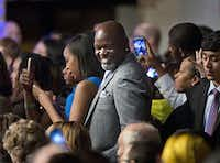 Former NFL Dallas Cowboys' football running back Emmitt Smith, center, in the audience to listens to President Barack Obama speaks at a Democratic National Committee (DNC) fundraiser at Gilleyís Club in Dallas, Saturday, March 12, 2016. (AP Photo/Pablo Martinez Monsivais)