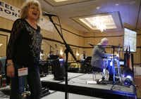 Sissy Privitt of Texarkana (left) sings with Buck Grantham of Denham Springs, La., during the Steel Guitar Jamboree held March 14-16 at the Sheraton DFW Airport in Irving,(Staff photo by MICHAEL AINSWORTH - DMN)