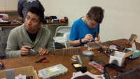 Alejandro Hernandez (left) and Jack Doan work on electrical components of the Blender at the 2015 RoboGames competition in San Mateo, Calif.( Photo submitted by NUSHA LALEH )