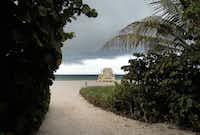A passing cloudburst creates dramatic skies around a Sunny Isles Beach, Florida, lifeguard stand.