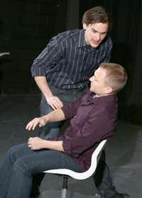 """Montgomery Sutton rehearses a scene from """"The Ugly One"""" with Jeff Swearingen, seated, at the WaterTower Theatre."""