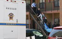 Investigators removed the body of an assault suspect from a Lake Highlands apartment Thursday. (David Woo/Staff Photographer)