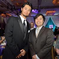 Tak Fujita of Irving, right, with Texas Rangers pitcher Yu Darvish at the Texas Rangers Foundation fundraiser at the Hilton Anatole in Dallas.Facebook