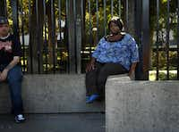 Tamica Millard sat at the DART bus stop in front of Parkland Memorial Hospital where she slept on the concrete wall after her discharge from the hospital. A DART officer woke her up that morning, but it would be more than five hours before she would find her relatives.