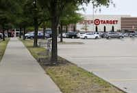 Christine Thi Woo was found dead at a Super Target at Custer Road and State Highway 121. (Vernon Bryant/Staff Photographer)