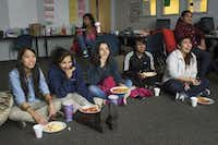 Lesly (third from right) joined other members of the Girls of Technology club at Singley Academy on Friday to watch the movie Battleship after school. Twice a month, the Girls of Technology meet for candy, charades or movies in a basement classroom.Matthew Busch  -  Staff Photographer