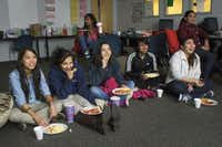 Lesly (third from right) joined other members of the Girls of Technology club at Singley Academy on Friday to watch the movie Battleship after school. Twice a month, the Girls of Technology meet for candy, charades or movies in a basement classroom.( Matthew Busch  -  Staff Photographer )