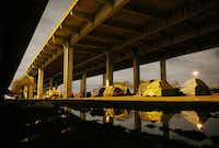 """A view of """"Tent City,"""" the massive homeless encampment under Interstate 45, near downtown Dallas Thursday March 10, 2016. (Andy Jacobsohn/The Dallas Morning News)"""