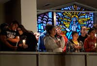 West residents at a candlelight vigil Thursday in St. Mary's Church of the Assumption.