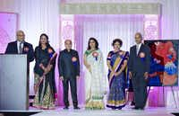 Incoming TIPS president Dr. Nabeel Syed (left) introduced his board at a fundraiser Saturday at the Irving Convention Center.( Prasad Golkonda )