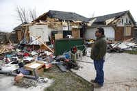 Days after the Dec. 26 tornado, Felix Salazar surveyed the damage the twister dealt to the family's home on Cresthill Lane in Garland.( Nathan Hunsinger  -  Staff Photographer )