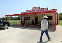 A diner walks to Kirby's Barbeque in Mexia, Texas, on August 2, 2013 during the Posse's Heart of Texas BBQ Tour. Kirby's was one of two top stops on the tour.