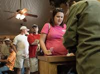 A long line of Friday lunch customers wait to order at Kirby's Barbeque in Mexia.