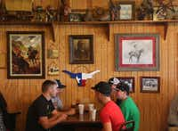 Diners eat under a wall of Indian memorabilia at Kirby's Barbeque. Kirby's, located not far from historic Fort Parker, is also a mini-museum of photos and artifacts of Native Americans. In 1836, a young girl, Cynthia Ann Parker, was captured during the Fort Parker massacre. She became the mother of Quanah Parker, the famous Comanche chief.