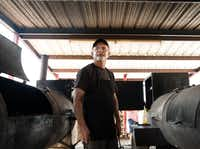 """Pitmaster and owner Kirby Hyden poses between the dual offset wood-burning smokers at Kirby's Barbeque. """"In this part of the world, if they don't come back and see you, you don't stay in business very long. """"Kirby's owner and pitmaster Kirby Hyden said of his loyal customers."""