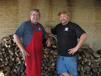 Owner Dirk Miller, left, and pitmaster Robert Reid pose by the woodpile at Miller's Smokehouse. Individual Posse members had previously sampled Miller's and loved it, but this was our first group visit to the joint, located just a few minutes off of Interstate Highway 35.