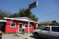 A customer leaves Wright's Bar-B-Q in Mexia, Texas, our first stop on the Posse's Heart of Texas BBQ Tour.