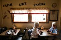 Customers wait for their orders at Wright's Bar-B-Q in Mexia.