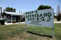 """A hand-painted sign welcomes you to Whup's Boomerang Barbecue in Marlin. Whup's owner-pitmaster Ben Washington told us he added """"boomerang"""" to the joint's name to convey the idea of customers always returning."""