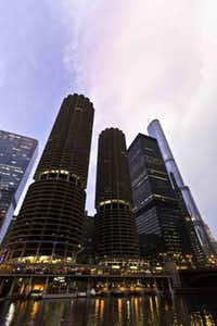 Marina Towers in Chicago spiral above the Riverwalk.