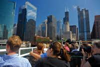 Passengers click away as tour boats course the Chicago River and its North and South Forks.
